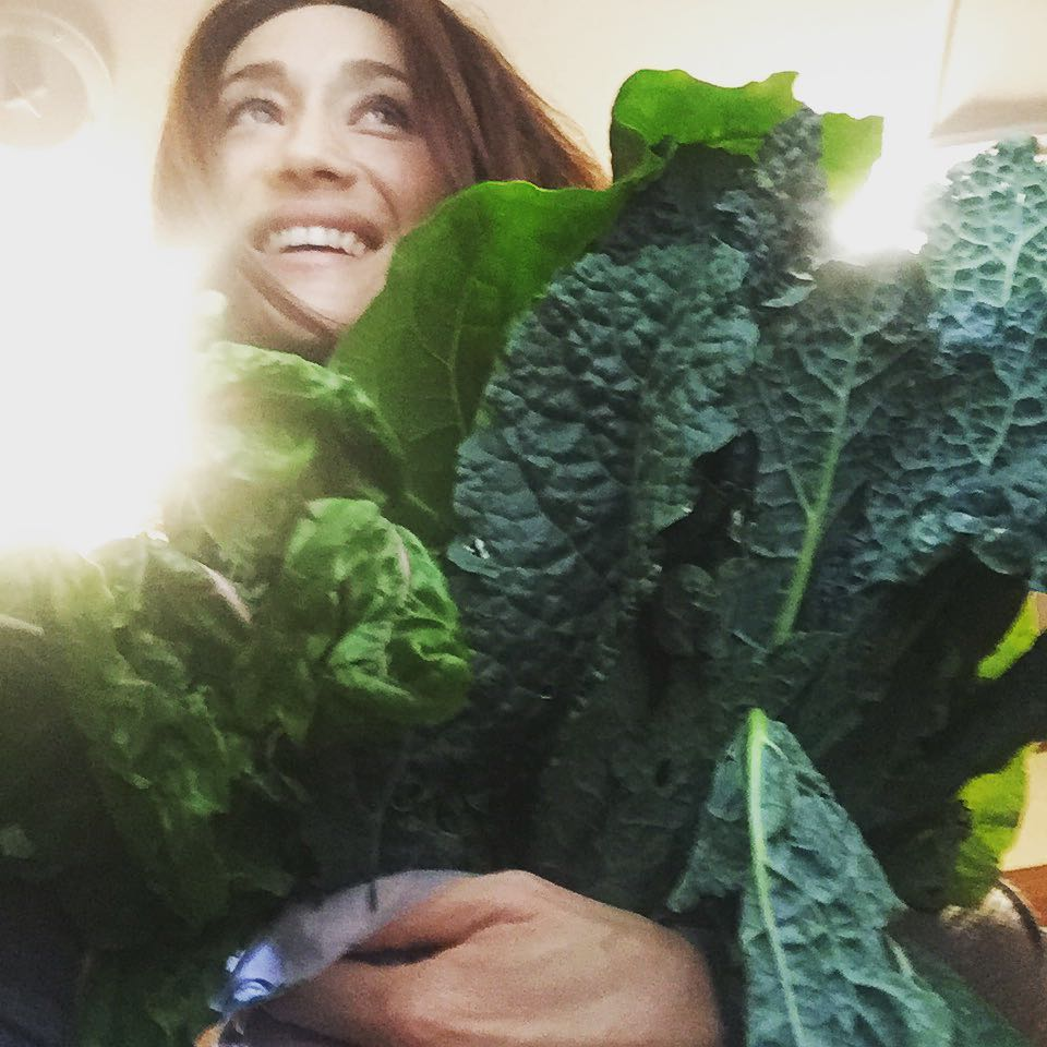 'Sexiest Vegan' Maggie Q hugging a bunch of kale