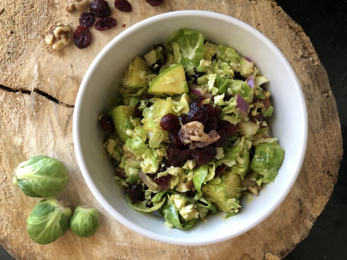 Brussels sprouts salad with cranberries, apple, maple, dijon