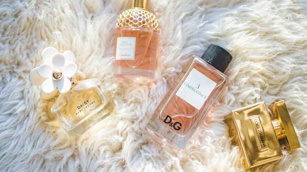 four bottles of perfume on a rug