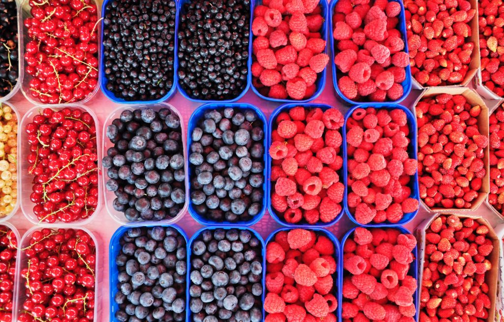 Colorful summer berries in baskets